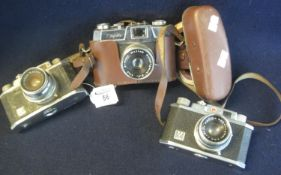 Three Halina 35mm viewfinder cameras to include 35X (2) and Halina super 35X in everready case. (