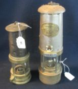 Two brass miner's safety lamps, including a smaller one in used condition and an E Thomas & Williams