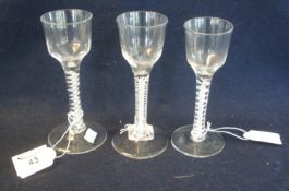 Three similar Georgian opaque multiple twist stem ale glasses with circular feet, two with
