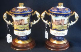 Two Aynsley bone china hand painted lidded two handled commemorative vases for Her Majesty Queen