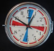 An Astra chrome finish wall clock with blue and red quadrants to the white Arabic face. Modern