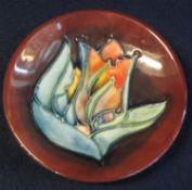 Modern Moorcroft art pottery dish with tube lined floral decoration. Impressed marks to base with