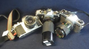 Three Pentax 35mm SLR camera bodies including an ME, together with Pentacon 3.5/30 lens, a Centon