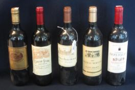 Five bottles of red wine to include; Chateau Belaire Sant Emilion Grand Cru 2001, Chateau Beaumont
