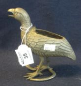White metal sculptural study of a Quail or Partridge, standing upon a snake. Lacking cover to its
