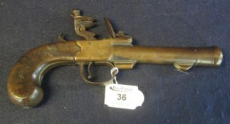 18th Century brass barrelled muzzle loading flintlock blunderbuss pistol, having 13cm cannon mouthed