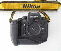 Nikon F4 35mm Film Camera Body with motor drive and removable view finder.
