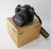 Nikon D200 Digital SLR Camera Body With MB-D200 Battery Pack together with a Nikon Nikkor 24-120mm