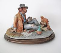 A Capodimonte porcelain figure of an old man and his squirrel, late 20th/ early 21st century. H18cm,