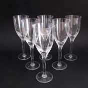 A set of six Lalique crystal Angel champagne flutes with frosted angel heads to the stems and etched