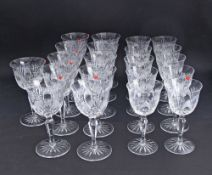 A collection of Bohemian hand cut lead crystal glasses comprising of eleven tall wine glasses H18cm,