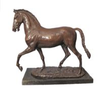 A patinated bronze figure of a prancing horse on a black marble base, late 20th / early 21st