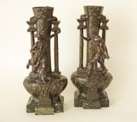 A pair of Large French Art Nouveau Patinated Spelter Figural Vases, c. 1910, the tapered bulbous