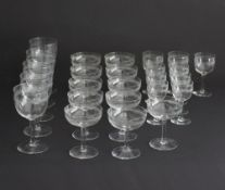 A collection of fine 1930s hand blown and etched glasses comprising of five large goblets, eleven