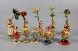 Konvolut Erzgebirge BlumenkinderErzgebirge, Konvolut farbig gefasster Holzfiguren mit langen