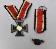 Eisernes Kreuz mit Knopfloch-BandrolleEisernes Kreuz 2. Klasse, datiert 1813/1939, Nummer 65 für