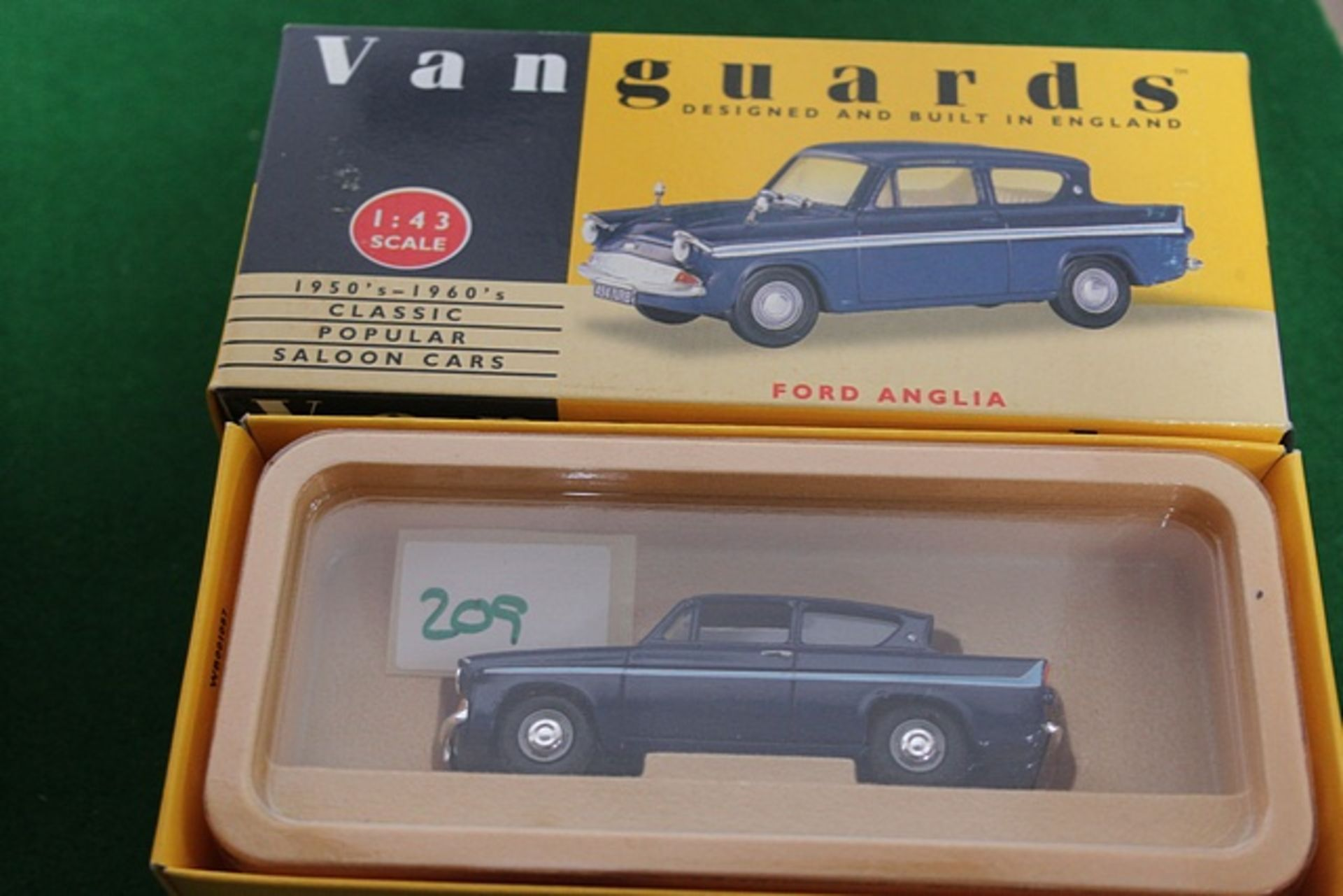 Lot 209 - Vanguards # VA1000 1950s To 1960s Classic Popular Ford Anglia In Navy Cale 1/43 Complete With Box