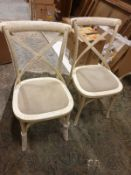 **Clearance Bargain** A pack of 2 understated cross back chairs in a distressed white wood finish