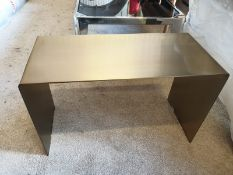A brushed steel waterfall single piece side table constructed of solid stainless steel in brushed