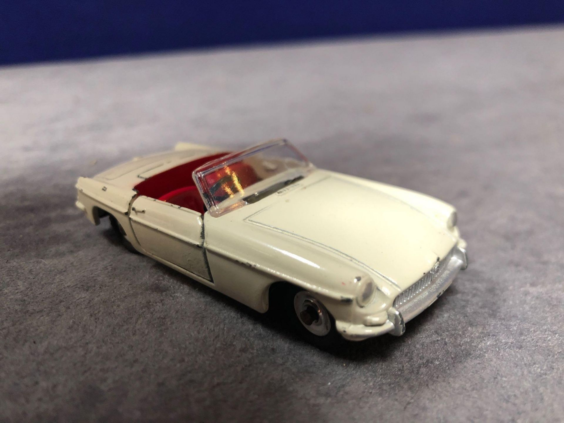 Dinky 113 MGB Cream Red Interior 1962-1968 Unboxed missing driver very good model some wear but - Image 2 of 4