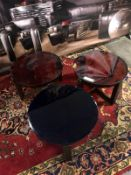 3 x small coloured glass tables with cast metal base. (heavily chipped)