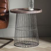 Menzies Side Table The Menzies side table features a caged gun-metal frame and base with a weathered