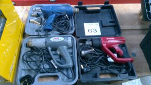 3 No. Assorted heat guns with various nozzles and cases