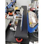ATG Pharma model ALR-1000 Table Top Wrap Around Labeler