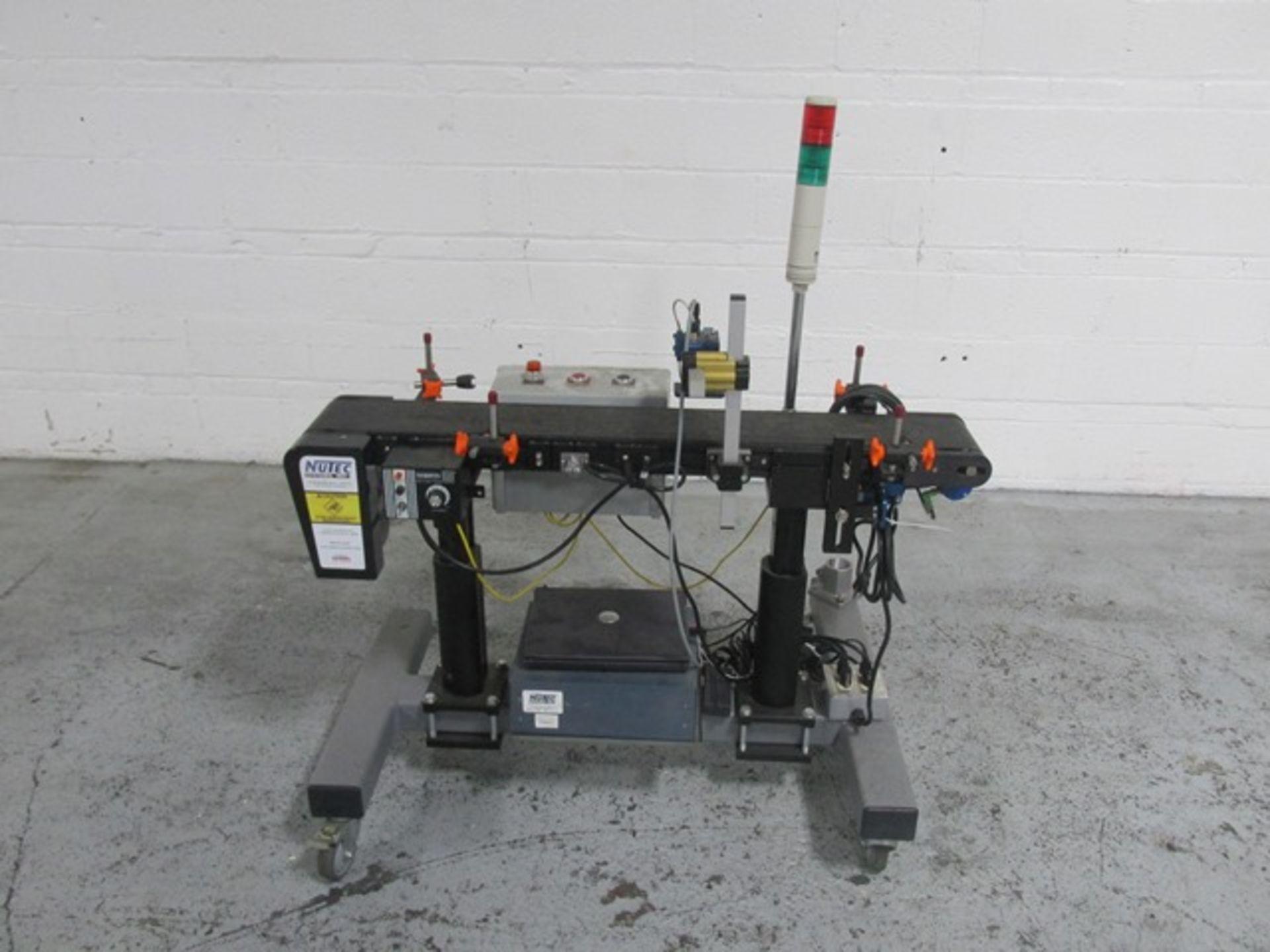 "Lot 23 - Nutech box printer, model RT-1000, with 6"" wide x 48"" belt conveyor, printer head, serial# 05004."