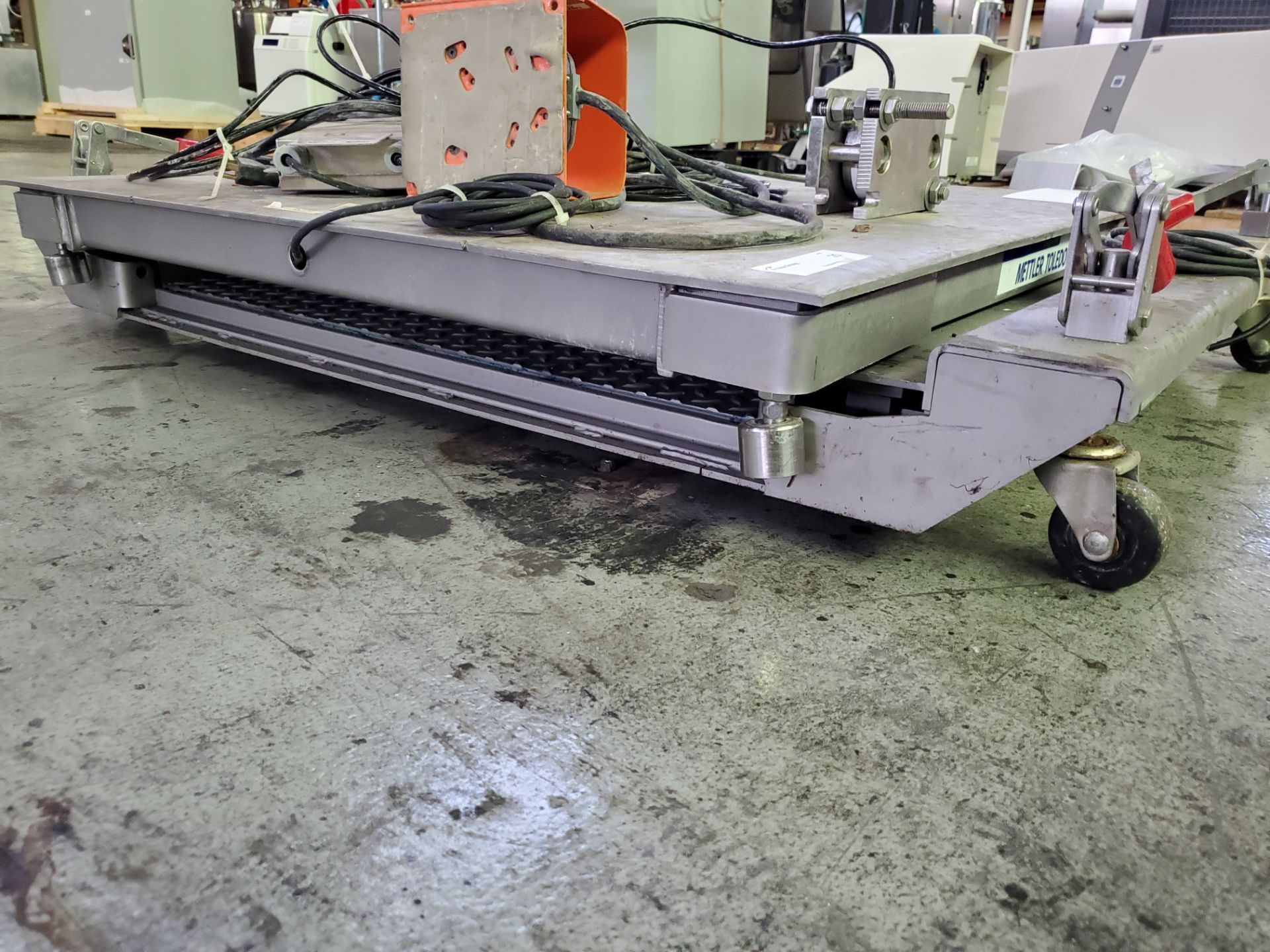 "Lot 25 - (2) Mettler Toldeo Floor Scales, 36"" x 36"" and 38"" x 30"" platforms, no readouts."