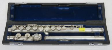 Muramatsu flute with case. Serial number: GX82024. Please note that this item is sold as