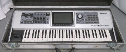 Roland Fantom 66 keyboard in flight case. Serial number: ZY67873.