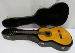Washburn Enrique Tapicas C8S acoustic guitar with case. Serial number: 96010012.