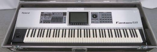 Roland Fantom G8 keyboard in flight case. Serial number: ZY77128.
