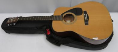 Yamaha FG142 acoustic guitar with case. Serial number: 91019490.