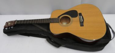 Yamaha FG-412 acoustic guitar with case. Serial number: 9109432.
