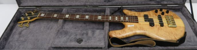 Spectre bass guitar in flight case. Serial number: NB8019.