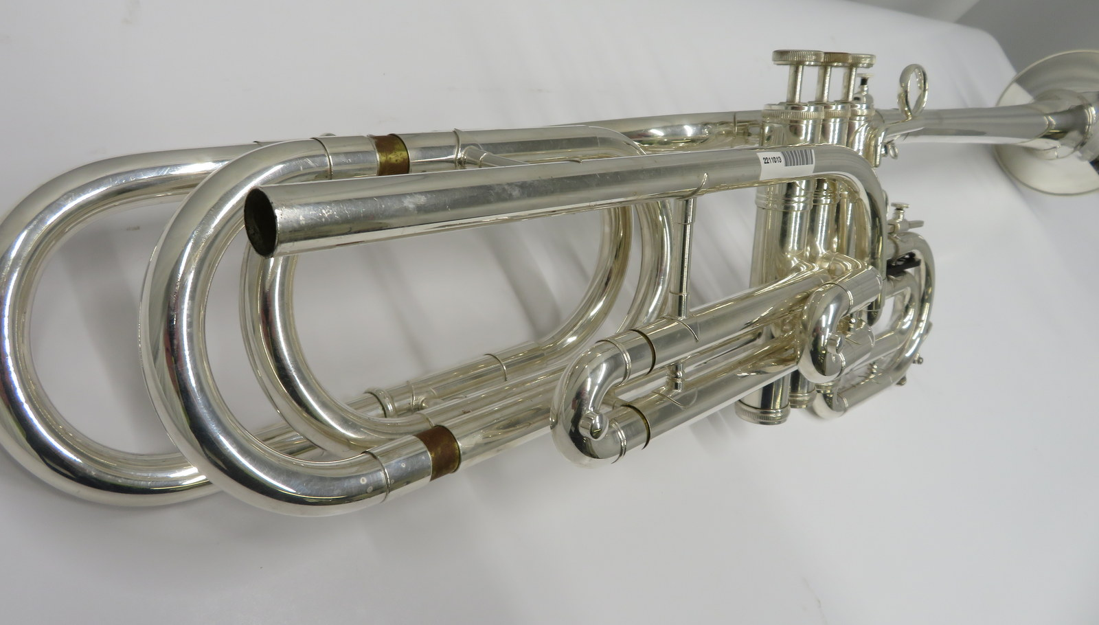 Lot 10 - Smith-Watkins fanfare trumpet with case. Serial number: 33104.