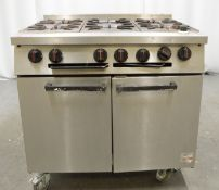 Falcon 6 burner range oven, natural gas (one damaged wheel front right)