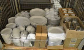 Metal tea pots, cappuccino cups, plates, tea cups