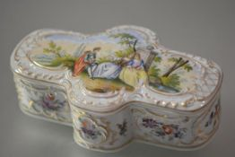 A German porcelain box, shaped cruciform, in 19th century style, decorated with courtly figures