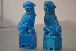 A pair of large Chinese turquoise glazed porcelain models of Buddhistic lion dogs, modelled