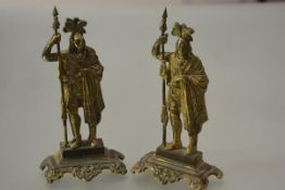A pair of 19th century gilt-brass chimney ornaments, each modelled as a Native American chieftan