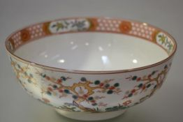 A Chinese Export porcelain punch bowl, c. 1800, decorated in iron red, gilt and polychrome enamels