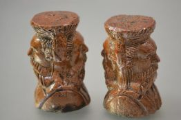 A pair of unusual 19th century salt-glazed window stops, double-sided, each modelled as a bearded