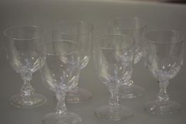 A set of six glass rummers, c. 1900, each bowl panelled to the base on a waisted baluster stem and a