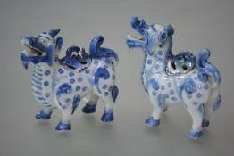 A pair of Chinese blue and white porcelain zoomorphic censers, each stoutly potted and modelled as a