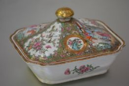 A Canton famille rose porcelain vegetable tureen, 19th century, of shaped rectangular form, the