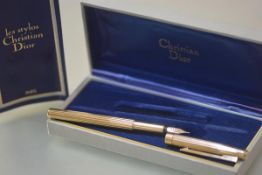 A Christian Dior silver-gilt fountain pen with signed 14ct gold nib, with ribbed body, cased with