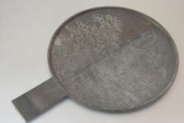 An unusually large Japanese bronze mirror, Meiji period, the reverse cast in relief with cranes